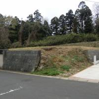 Groundwork: Land for sale atop a hill, revealing an open section of its retaining wall. | PHILIP BRASOR