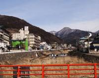 Warm welcomes: Shibu Onsen (above) upriver from Yudanaka is a good base for visiting the bathing macaques of Jigokudani.