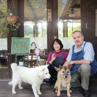 Happy families: Alice (left), her daughter, the writer's Rhubarb, and hosts Phil and Akiko Bennett at their friendly Cafe' Manna.