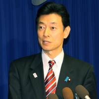 On trade: Yasutoshi Nishimura, senior vice minister in charge of economic and fiscal policy, addresses reporters Tuesday in Washington. | KYODO
