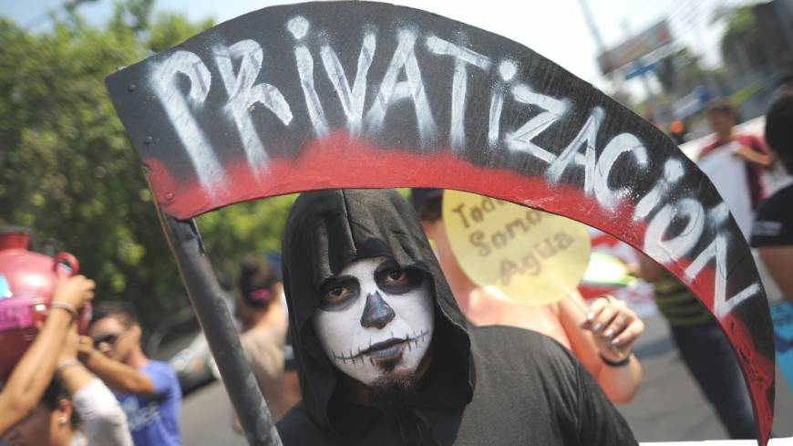 An El Salvador university student in San Salvador protests against privatization during a Labor Day rally on Wednesday.