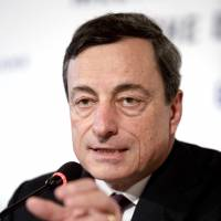Looking for answers: Mario Draghi, president of the European Central Bank, holds a news conference following the ECB rate announcement in Bratislava on Thursday. | BLOOMBERG
