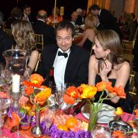Happier times: Billionaire John Paulson (center) attends dinner during the School of American Ballet Winter Ball in New York in March. Paulson's bet on gold took a downturn recently, costing him nearly $1 billion during a two-day period. | BLOOMBERG