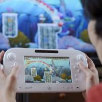 Nintendo taps smartphone apps for console boost
