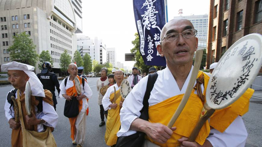 Off the warpath: Buddhist monks participate in a march against Prime Minister Shinzo Abe's calls to amend the war-renouncing Constitution in Tokyo on the Constitution Day holiday Friday. Hundreds of people, young and old, gathered downtown for a peaceful protest against Abe's efforts to give the government more power to abridge civil liberties.