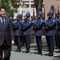 Economic detour: Prime Minister Shinzo Abe inspects a Turkish military honor guard in Ankara on Friday. | AP