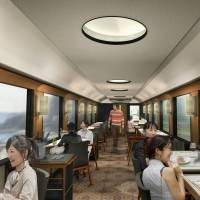Fast food: Models dine in a mockup of a JR East restaurant train that will debut this fall in the northeast. | JR EAST / KYODO