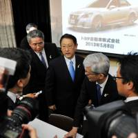 On track: Toyota President Akio Toyoda (center) is surrounded by reporters after a press briefing in Tokyo on Wednesday. | AFP-JIJI