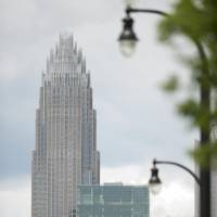Behemoth: Bank of America's corporate headquarters towers above the uptown area of Charlotte, North Carolina. At its annual shareholders' meeting across the street on Wednesday, CEO Brian T. Moynihan said the bank needs to show a steady stream of profit before satisfying demands for a higher dividend. | BLOOMBERG