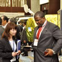 Networking: Attendants at the two-day Japan Sustainable Mining, Investment and Technology Business Forum (J-SUMIT) on how to utilize Africa's natural resources exchange information Thursday on the sidelines of the Minato Ward event. | KYODO