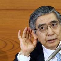 All ears: Bank of Japan Gov. Haruhiko Kuroda faces reporters April 26 in Tokyo. | BLOOMBERG
