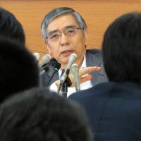 Bank on it: Bank of Japan Gov. Haruhiko Kuroda faces reporters Wednesday at BOJ headquarters in Tokyo. | AFP-JIJI