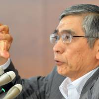 A target too far: Bank of Japan Gov. Haruhiko Kuroda speaks during a news conference at BOJ headquarters in Tokyo on Wednesday. | AFP-JIJI