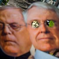 America's real choice: Holding pictures of the Koch brothers, protesters in Beverly Hills, California, on Thursday demand that the Los Angeles Times not be sold to the billionaires. | AFP-JIJI