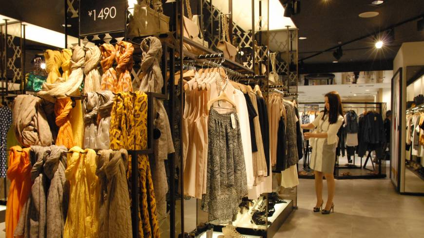 Asian rival arrival: A customer checks out clothes at Mixxo, a South Korean 'fast fashion' outlet, at the Sogo department store in Yokohama earlier this month. Mixxo entered the Japanese market in March.