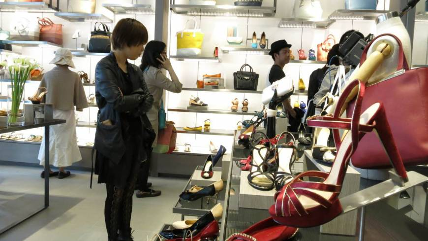 Shoe-in: Customers look at shoes at Singapore-based Charles & Keith's store in Tokyo's Harajuku district in April.
