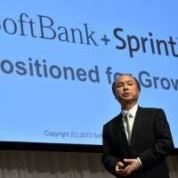 Hard and fast: Softbank Corp. President Masayoshi Son speaks during a news conference in Tokyo on April 30. | AFP-JIJI