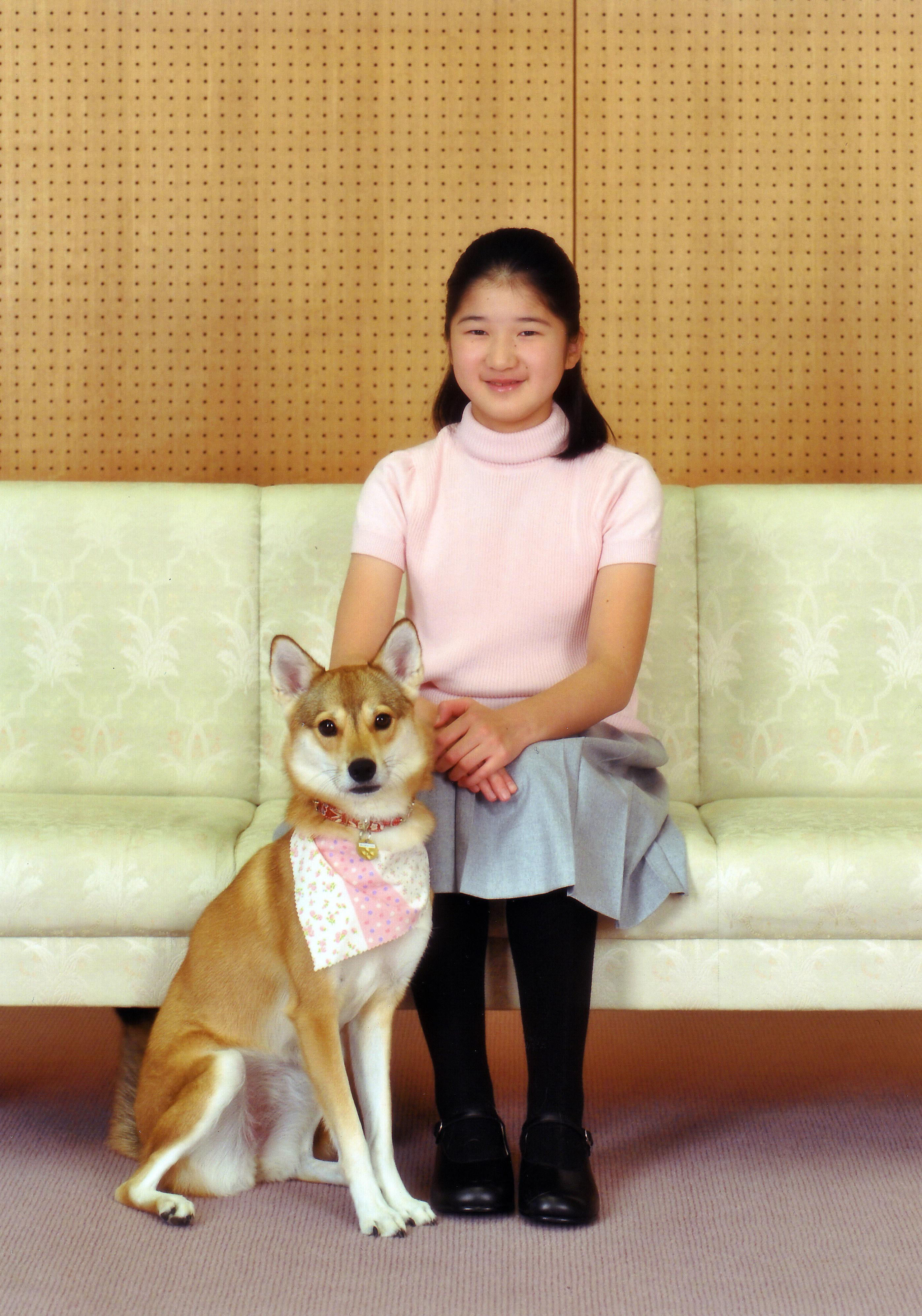 Big girl: Princess Aiko, who turned 11 Saturday, poses with her pet ...