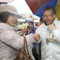 Pressing the flesh: Your Party leader Yoshimi Watanabe works the crowd in Nasu, Tochigi Prefecture, on Tuesday. | KYODO