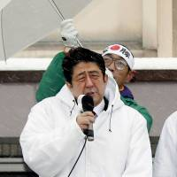 Once and future prime minister?: Liberal Democratic Party leader Shinzo Abe speaks to the crowd in the snow Monday in Joetsu, Niigata Prefecture. | KYODO
