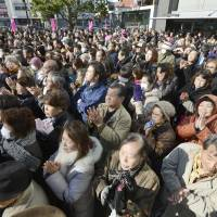 Warmly received: Kansai voters applaud after listening to a candidate running in Sunday's Lower House election give a speech in Nishinari Ward, Osaka, last Thursday. | KYODO