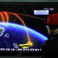 Telemetry lesson: A man watches a  TV screen broadcasting news of North Korea's rocket launch at a railway station in Seoul on  Wednesday. | AFP-JIJI