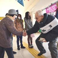 True vet: Ryokichi Kawashima, 94, an independent candidate running in Sunday's general election, meets voters Thursday in Hanyu, Saitama Prefecture. | AFP-JIJI