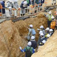 Digging a nuclear grave?: Experts from the Nuclear Regulation Authority conduct a geological survey Dec. 2 of a fault running beneath the Tsuruga nuclear plant in Fukui Prefecture that was later determined to be likely active and highly dangerous. | KYODO