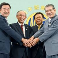 Face time: Tokyo gubernatorial candidates (from left) Shigefumi Matsuzawa, Kenji Utsunomiya, Naoki Inose and Takashi Sasagawa hold a debate Nov. 28 at the Japan National Press Club. | KYODO