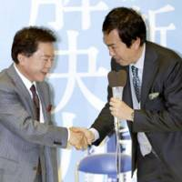 Naoki Inose (left), Tokyo's next governor, is congratulated by Nobuteru Ishihara, former secretary general of the Liberal Democratic Party, at his election office in Shinjuku Ward. | KYODO