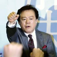 Resounding victory: Tokyo Gov.-elect Naoki Inose celebrates with supporters at his campaign office Sunday evening. | KYODO