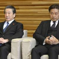 Keeping the seats warm: Health minister Wakio Mitsui (left) and financial services minister Ikko Nakatsuka &#8212; who both lost their Diet seats in Sunday's general election &#8212; attend a Cabinet meeting Tuesday. | KYODO