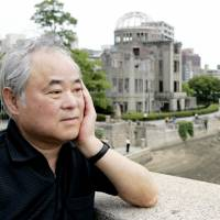 Spanning generations: Keiji Nakazawa, author of 'Hadashi no Gen' ('Barefoot Gen'), takes in the view from Hiroshima's Aioibashi Bridge, where he played as a boy, in June 2008. | KYODO