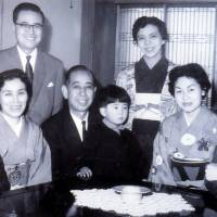 Connected kid: Kindergartner Shinzo Abe sits on the lap of his grandfather, then-Prime Minister Nobusuke Kishi, while his father, Shintaro Abe (right), mother, Yoko (standing), and older brother, Hironobu (left), pose for a family photo. | SHINZO ABE OFFICE / AP