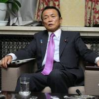 Aso slams DPJ predecessors, talks of keeping BOJ close