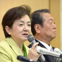 Separate ways: Shiga Gov. Yukiko Kada faces reporters Friday in Otsu to discuss the breakup of Nippon Mirai no To (Tomorrow Party of Japan) as political heavyweight Ichiro Ozawa listens. | KYODO