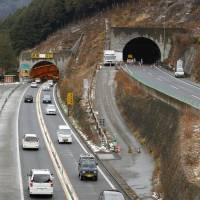 Road narrows: The outbound portion of the Sasago Tunnel in Yamanashi Prefecture opens to two-way traffic Saturday after the ceiling of the Tokyo-bound side collapsed earlier this month. | KYODO