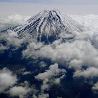 National icon: Mount Fuji, seen from the air Wednesday, is on the way to winning World Heritage status. | KYODO