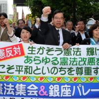 HeadlineKeeping the faith: Japanese Communist Party chief Kazuo Shii (third from right) and Mizuho Fukushima (fourth from right), who heads the Social Democratic Party, march with other protesters in Tokyo's Hibiya district on Friday. | YOSHIAKI MIURA