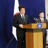 Cross-party plea: Prime Minister Shinzo Abe attends a news conference Friday in Ankara where he urged opposition groups Nippon Ishin no Kai (Japan Restoration Party) and Your Party to assist his goal of revising the Constitution. | KYODO