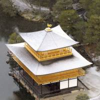 At risk: Kinkakuji (the Golden Pavilion), one of Kyoto's most precious cultural jewels, is dusted with snow Dec. 10. | KYODO