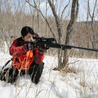 Hokkaido researcher uses a gun to study deer-control issue