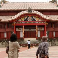 Who owns it?: People visit Shuri Castle in Naha, Okinawa Prefecture, in February 2012. | BLOOMBERG