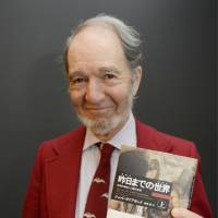 Old knowledge: Jared Diamond, an American scientist, displays a copy of the Japanese edition of his book 'The World Until Yesterday: What Can We Learn from Traditional Societies?' in February in Tokyo. | KYODO