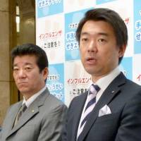 Diet snub: Nippon Ishin no Kai (Japan Restoration Party) coleader Toru Hashimoto and Secretary General Ichiro Matsui answer reporters' questions in Osaka on Feb. 27. | KYODO