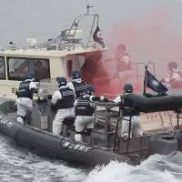 Thinking the unthinkable: Police and the Japan Coast Guard stage a joint drill Saturday against a terrorist attack at the Fukushima No. 2 nuclear plant, practicing countermeasures on both land and sea. | KYODO