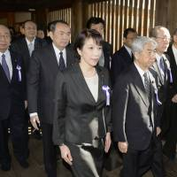 Defiant: Liberal Democratic Party policy chief Sanae Takaichi (center) and other Diet politicians visit war-linked Yasukuni Shrine in Chiyoda Ward, Tokyo, on April 23.