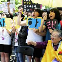 Enraged: A South Korean former 'comfort woman' joins compatriots Wednesday outside the Japanese Embassy in Seoul to slam Osaka Mayor Toru Hashimoto's remarks that Japan's wartime sex slave system was needed to maintain military discipline. | KYODO