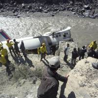 Overshot: Recovery crews and others view the wreckage of a Nepal Airlines Twin Otter that crashed Thursday in the Kaligandaki River in Jomsom, about 200 km northwest of Katmandu. | AP/KYODO