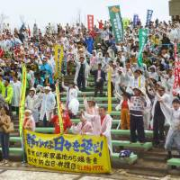 Making their point: Participants in a rally Sunday in Ginowan, Okinawa, call for a peaceful prefecture free of military bases 41 years after its reversion to Japanese administration. | KYODO